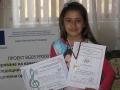 1 Емили Калинова от II клас с наградите за народно пеене.jpg